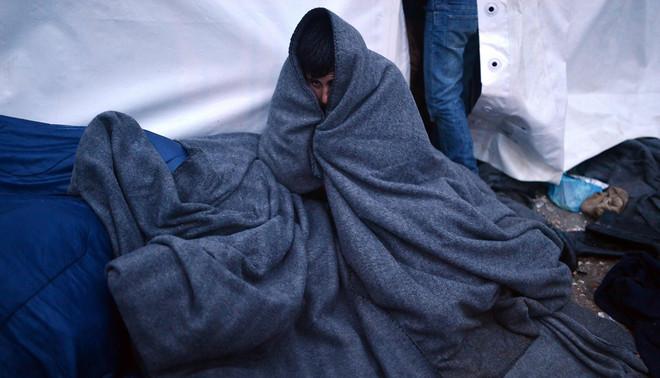 Vluchtelingen zijn gestrand op de grens van Griekenland en Macedonië, begin maart 2016. Foto: Louisa Gouliamaki / AFP