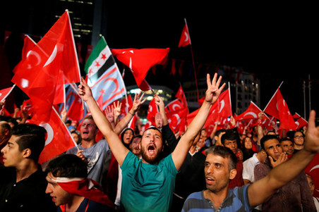 Pro-Erdogan supporters wave flags during a demonstration at Taksim Square on July 20, 2016 in Istanbul. Photo by Ammar Awad / Reuters