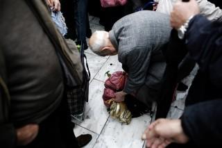 Gratis voedsel voor de armsten in Griekenland. Foto: Konstantinos Tsakalidis/Hollandse Hoogte