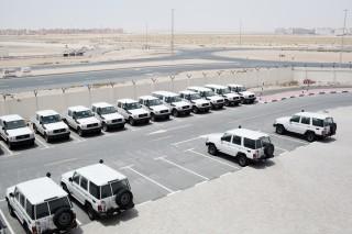 Auto's van de IFRC, die klaar zijn om naar een rampgebied getransporteerd te worden. Foto: Pieter van den Boogert