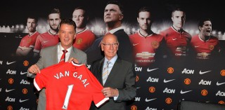 Louis van Gaal and Sir Bobby Charlton pose with a Manchester United jersey during Van Gaal's first press conference after becoming the new manager of United.