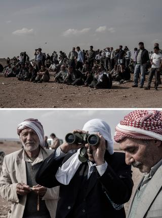 Op de 'Hill of Shame' bij de grens tussen Turkije en Syrië kijken mensen toe hoe anderhalve kilometer verderop in Kobani wordt gevochten. Foto's: Andreas Stahl