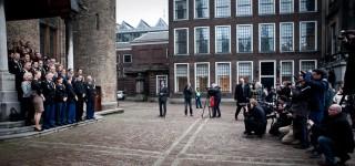 3 januari 2013: Ivo Opstelten (toen minister van Veiligheid en Justitie) poseert met de politietop tijdens de officiële start van de Nationale Politie. Foto: Julius Schrank/Hollandse Hoogte