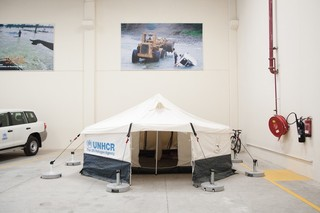 A UNHCR tent, set up to serve as a showroom model. Pieter van den Boogert for The Correspondent