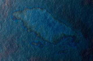 Olie gelekt uit de Deepwater Horizon van BP ligt op het wateroppervlak in de Golf van Mexico op 28 april, 2010. Foto: Chris Graythen / Getty Images