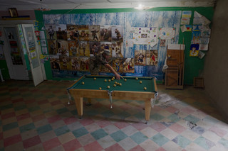 Vrijwilliger in het hoofdkwartier van het Oekraïense vrijwilligersleger in Pokrovs'ke. Foto: Andreas Staahl (voor De Correspondent)