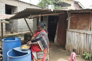Mary Wani follows the news on Radio Miraya. Juba, South Sudan. Photo by Charles Lomodong for De Correspondent