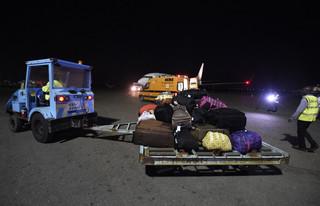 De bagage van de 150 migranten die vanuit Libië terugkeerden naar Lagos,  5 december 2017. Foto: Pius Utomi