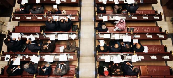 De constitutionele raad stemt op nieuwe grondwetsartikelen in de Shura raadszaal in Caïro. Foto: ANP
