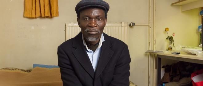 """Portret van Arthur (uit Liberia). Een foto uit de serie getiteld """"Vluchthaven"""" van fotograaf Ton Hendriks. Foto: Ton Hendriks"""
