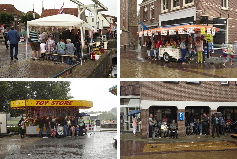Bezoekers van het Euifeest in Hasselt schuilen voor de regen. Foto's: Niels Stomps