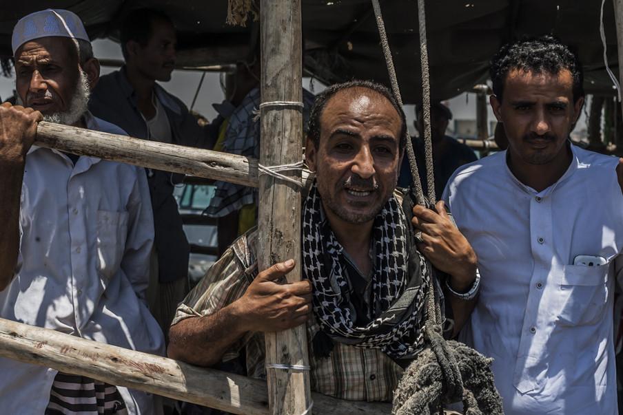 Vluchtelingen uit Jemen komen aan in Djibouti. Op de voorgrond Zakaria Hassan uit Sanaa. Foto: Andreas Stahl/AFP