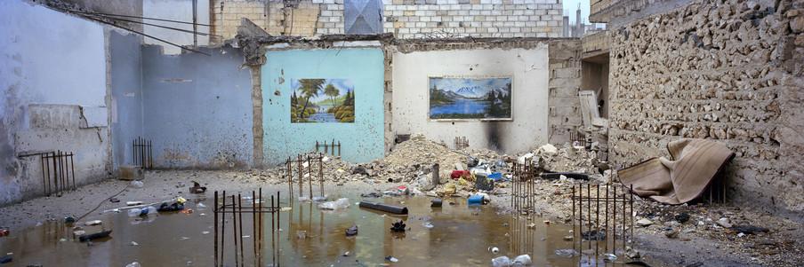 Een verwoest huis in Kobani