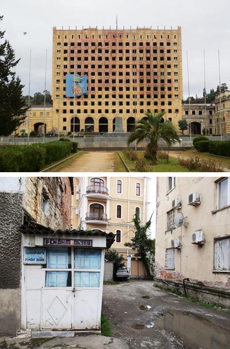 Boven: Het in de oorlog van 1992-1993 stukgeschoten regeringsgebouw in de Abchazische hoofdstad Soechoem. Onder: Een schoenmaker in het centrum van Soechoem. Foto's: Floris Akkerman