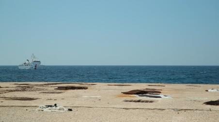 Een reddingsoperatie van de Italiaanse kustwacht arriveert op Lampedusa. Foto: Stefano Bertacchini/IKON