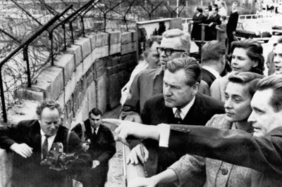 Nelson Rockefeller and his wife view sights on the east side of the Berlin Wall as pointed out by a West German guide. Photo by Hollandse Hoogte