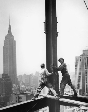 New York construction workers are seen with the Empire State Building in the background, 1950. Photo by Ben McCall / FPG / Hulton Archive / Getty Images