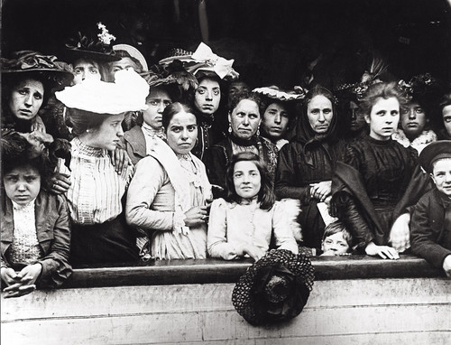 Immigrants on board a ship arriving in New York, 1910. Photo by Getty